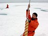 Removing an ice core.