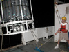 Just before midnight, Fred Andrus, helps to lower the 2400 lb CTD over the ship's starboard side.
