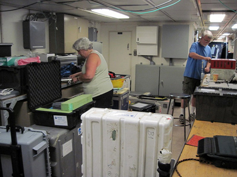 Scientists on the Northeast Lau Basin Exploration Team unpack and set up equipment.