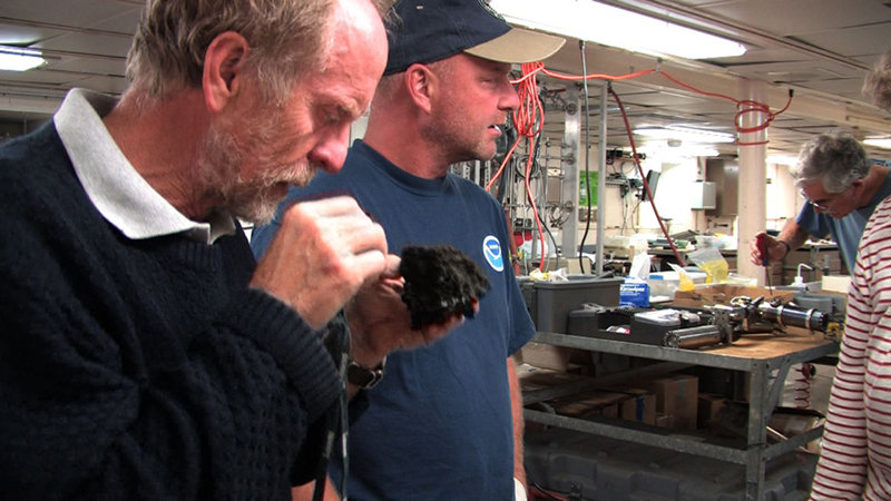 Drs. Richard Arculus (Australian National University) and Tim Shank (Woods Hole Oceanographic Institution) observe samples collected at Mata Ua.