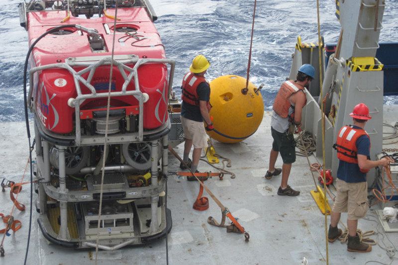 Lowering the buoy attached to the mooring as the hydrophone and other instrumentation near W. Mata is recovered.