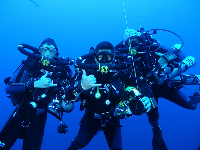 The technical dive team during an in-water decompression stop.