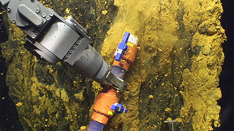 The scoop sampler allows the microbiologists to collect bulk samples of microbial mat.