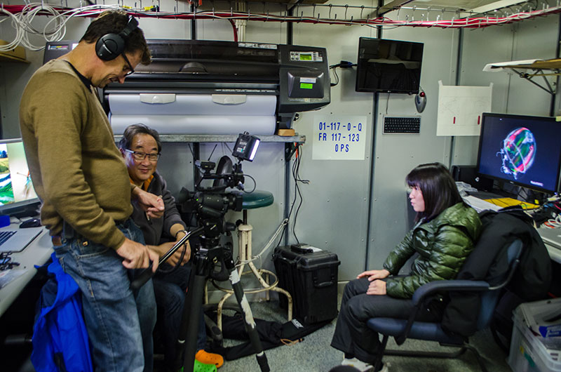 Michael Aw and Stuart Ireland from Ocean Geographic interview student Yui Takagi for their documentary.