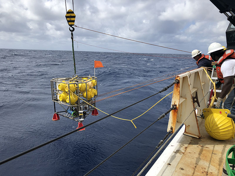 The deck crew of NOAA Ship Ronald H. Brown launches the NIOZ benthic lander for a long-term deployment on the seafloor near the coral mounds of Richardson Hills.