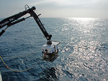 NOAA's new deepwater remotely operated vehicle, Deep Discoverer (D2), is deployed off the fantail of the ship for the first dive of the expedition.