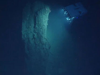 ROV D2 inspecting a large block of mudstone displaced from the wall of Heezen Canyon.