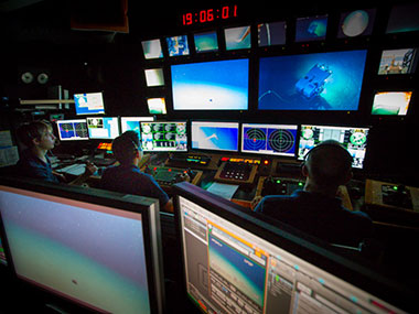 The control room of the Okeanos is as well coordinated as any live television studio.
