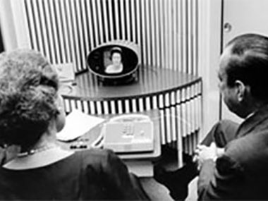The technical components of telepresence are older than you might think: Here, Mrs. Lyndon B. Johnson in Washington, DC, uses the Bell Labs PicturePhone to call Dr. Elizabeth Wood and then-Major Robert F. Wagner in New York City, in 1964.