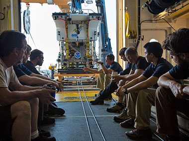 Dr. Brian Bingam conducts a pre-dive briefing with the ROV team.