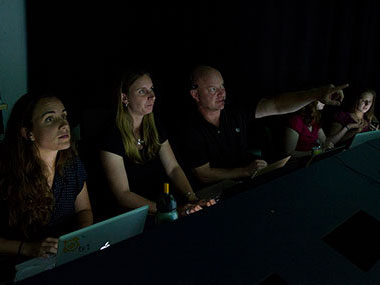 Telepresence provides many opportunities, including training the next generation of scientists. Here, Tim Shank, Co-science team lead for this cruise, and several of his students join the expedition from the Inner Space Center.