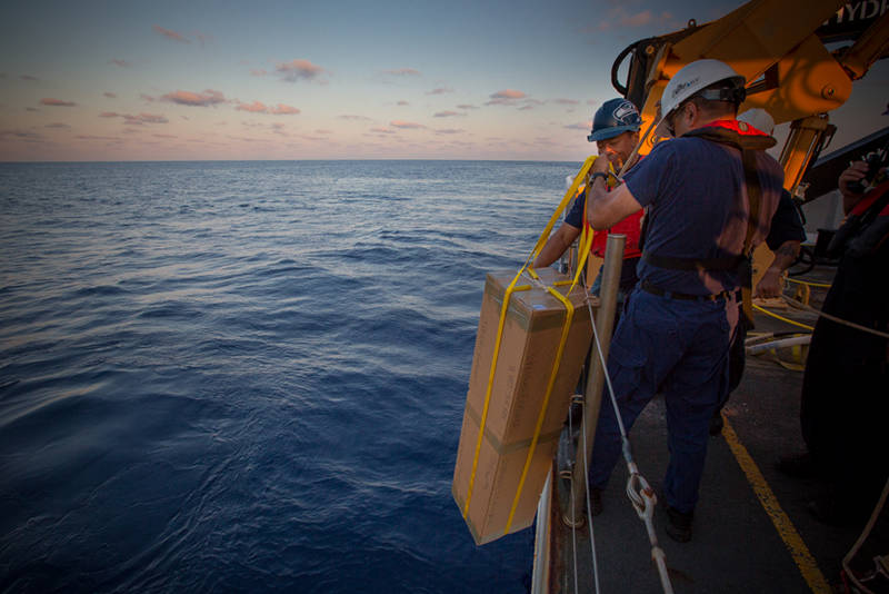 Okeanos Explorer crew members prepare to deploy the Argo float in the Gulf of Mexico.