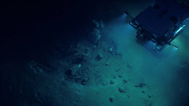 NOAA's Seirios camera platform images the ROV Deep Discoverer shining its lights on the stern section of Monterrey wreck site B.