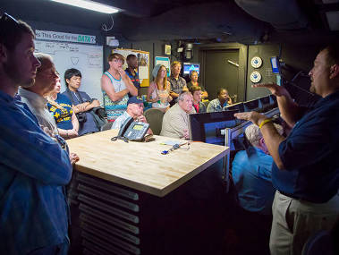 Roland Brian gives a tour of the control room and describes how ROV operations are conducted onboard Okeanos Explorer.
