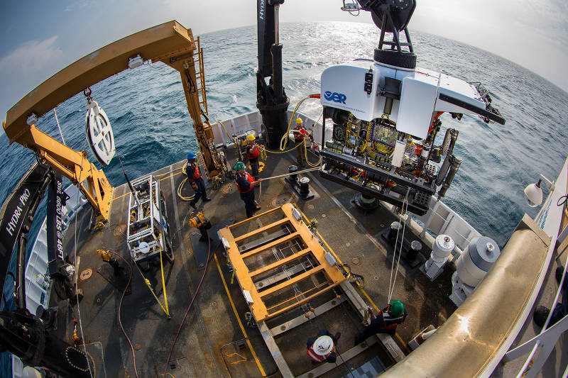 Okeanos Explorer's dual-body ROV system is loaded from the aftdeck of the ship into the water before conducting an exploration dive.