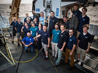 The on-ship exploration team poses with D2 at the end of the expedition.