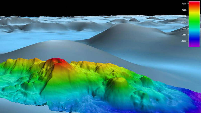 As the ship transits over the East Pacific Rise, scientists are using multibeam sonar to collect high-resolution mapping data, providing a more-detailed look at the seafloor and revealing previously unknown features, such as this knoll.