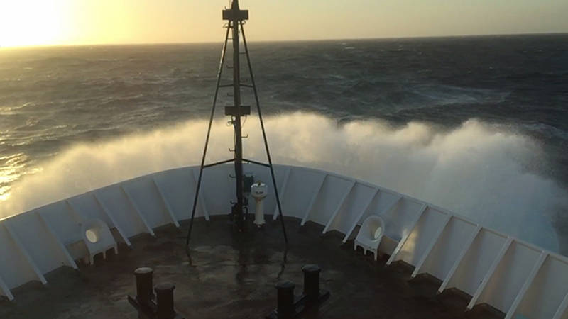 Rough seas break over the bow of NOAA Ship Okeanos Explorer during the transit back to Honolulu, Hawaii.