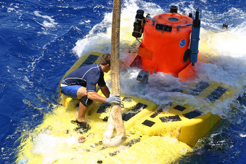 The Pisces V submersible being recovered after a dive during a HURL expedition. Launching and recovery of submersibles and remotely operated vehicles are non-trivial operations that present safety hazards, particularly in poor weather conditions or rough seas.