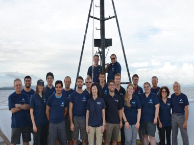 The shipboard mission team poses on the bow of the ship as Leg 3 comes to a close.