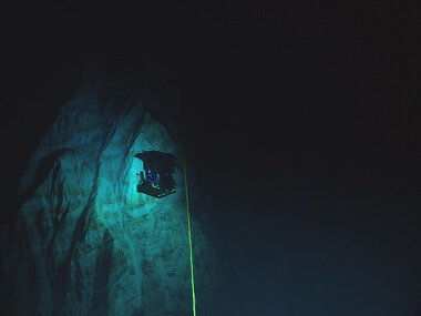 View of our ROV Deep Discoverer exploring at the depth of 6,000 meters in the Mariana Trench. Never-before-seen geological features reminiscent of the Alps and canyons in California stunned participating scientists on the ship and on shore.