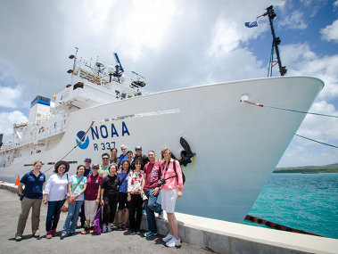 "A group of teachers in Guam took part in NOAA Office of Ocean Exploration and Research's ""Why Do We Explore"" professional development workshop. Here, the participants are photographed in front of the ship following a tour."
