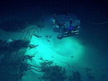 ROV Deep Discoverer discovers a B-29 Superfortress resting upsidedown on the seafloor.
