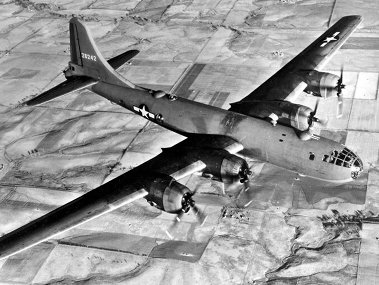 The B-29 Superfortress, designed by Boeing, fulfilled the need for a bomber capable of flying over 5,000 miles while carrying a large payload. It represented very advanced technology for the time with a pressurized cabin and a remote, computer controlled fire control system to direct four machine-gun turrets to protect against enemy aircraft attacks. The plane was used from June 1945 through the end of the war and included missions to drop supplies to prisoners of war in Japan.