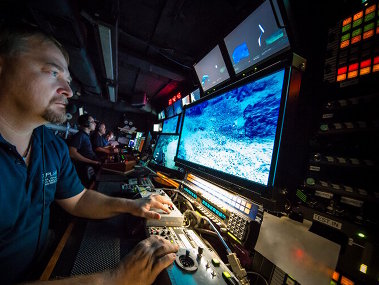 Video and telepresence engineer, Roland Brian, adjusts the camera focus of the main ROV HD camera during a dive to help the science team get the best view of features and animals of interest.