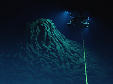 ROV Deep Discoverer explores an eruptive vent at the top of a large mound of pillow lavas.