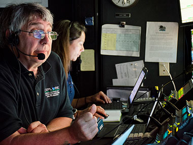 Science co-lead, Chris Kelley, and NOAA Educational Partnership Program Intern, Nikola Rodriguez, are hard at work in the control room aboard NOAA Ship Okeanos Explorer.