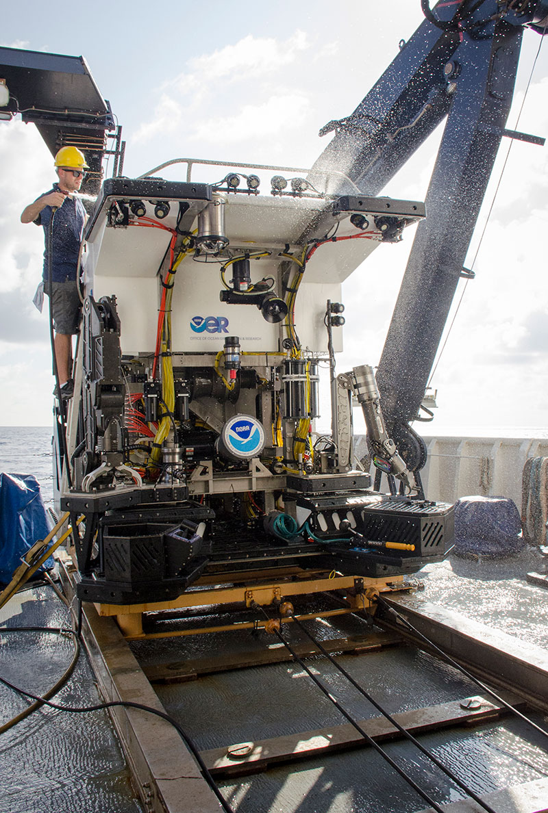 Dive Supervisor, Dan Rogers, rinses remotely operated vehicle Deep Discoverer with freshwater following the last dive of the Laulima O Ka Moana expedition.