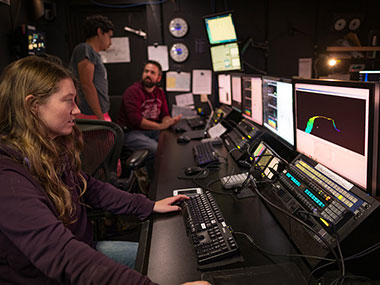 Mapping Watchstander, Neah Baechler, edits recently acquired multibeam data in the control room on NOAA Ship Okeanos Explorer.