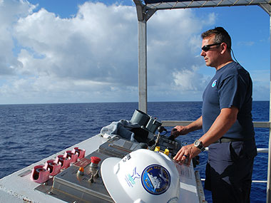 CDR Eric Johnson oversees deployment of the CTD rosette during a shakedown cruise on NOAA Ship Okeanos Explorer.