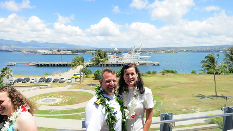 Eric Johnson with his wife, Angela, and NOAA Ship Okeanos Explorer in the background during the Change of Command in July 2017.