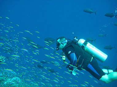 Eric Johnson diving at Jarvis Island in the equatorial Pacific when on the Hi'ialakai.