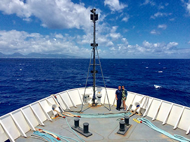 Eric Johnson with his wife on the bow of NOAA Ship Okeanos Explorer during the transit back to Pearl Harbor.