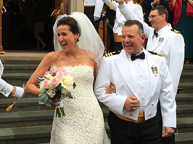 Eric Johnson with his wife, Angela, and NOAA Corps Officers during their recent wedding.