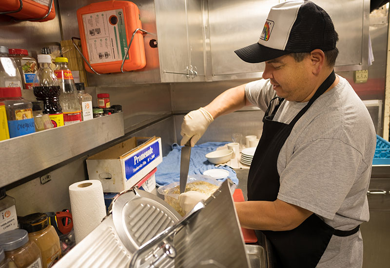 Chief Steward, Mike Sapien, hard at work, making sure the crew of 49 aboard NOAA Ship Okeanos Explorer is well fed.