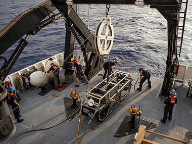 The Deck Team safely recovers the remotely operated vehicles after a dive.