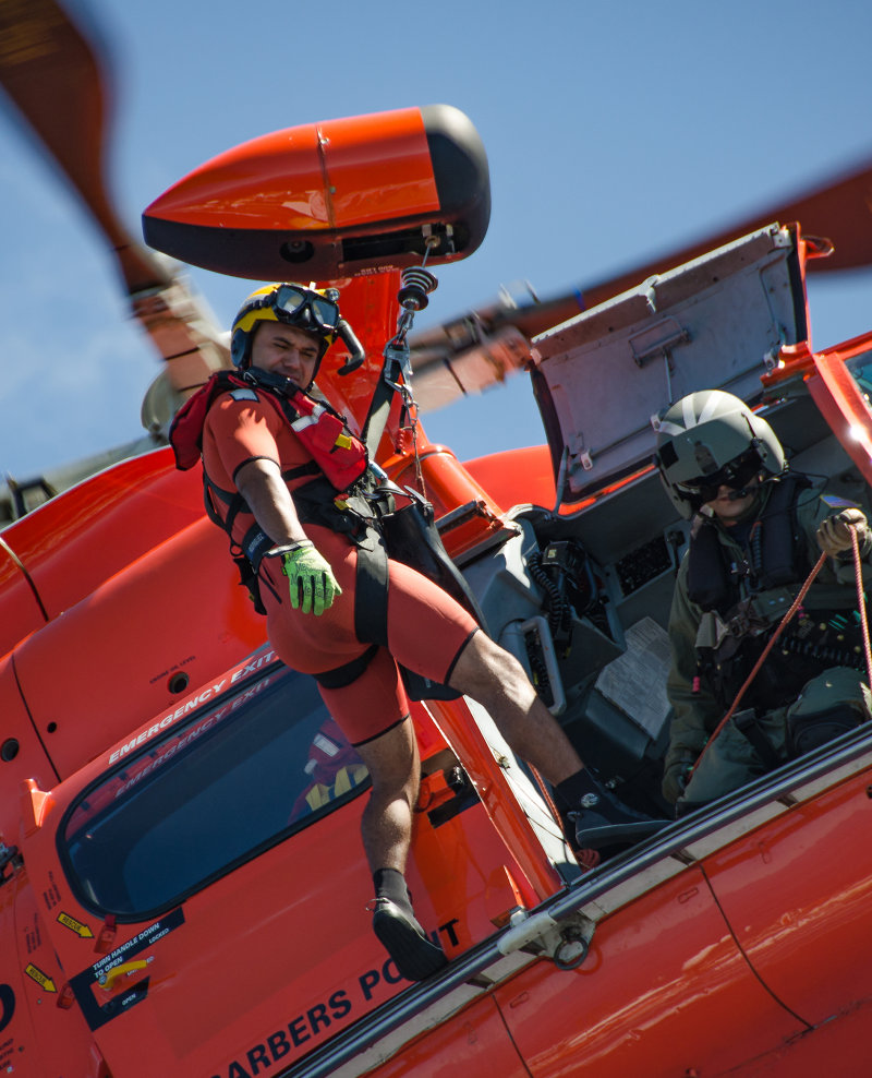 A U.S. Coast Guard rescue swimmer prepares to deploy during a training drill.