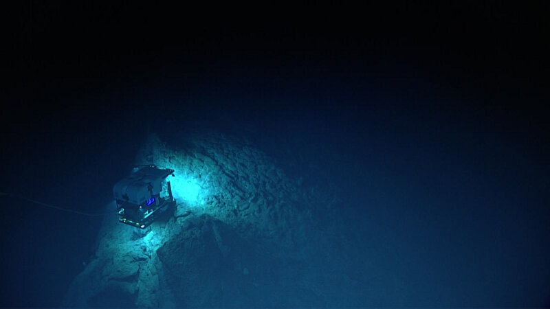 ROV Deep Discoverer explores the edge of a sharp ridge feature at Mozart Seamount.