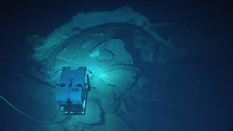 Remotely operated vehicle Deep Discoverer investigates some of the striking geology seen during the dive.