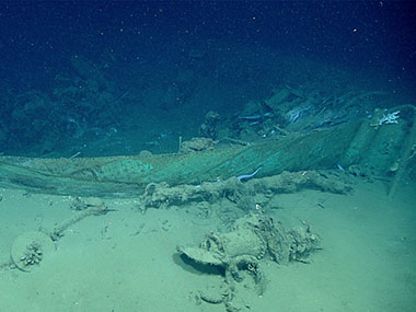 First view of the wreck's bow outlined by the remnant copper sheathing, with one hawse pipe in foreground and another just aft of the stempost at right.