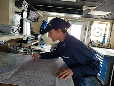 LT Abbitt plotting a fix at the charting table on the bridge of the Okeanos Explorer.