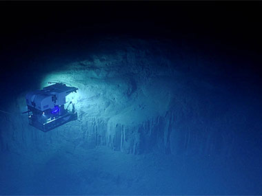 The remotely operated vehicle (ROV) <em>Deep Discoverer</em> surveys this interesting geological feature during the final dive of the Windows to the Deep 2018 expedition.