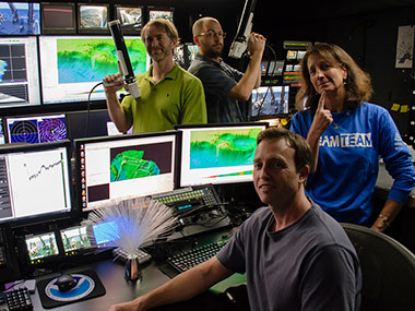The mapping team on NOAA Ship <em>Okeanos Explorer</em> having a little fun while working hard to collect much needed high-resolution mapping data in the data gaps along the southeastern U.S. continental margin.