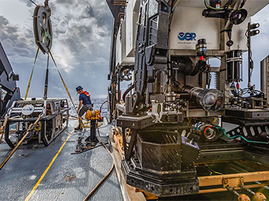 The team preps for the first remotely operated vehicle dive of the mission on a cloudy morning.