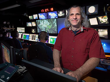 New Telepresence Coordinator for the NOAA Office of Ocean Exploration and Research, James Rawsthorne, working in the control room aboard NOAA Ship <em>Okeanos Explorer</em> while in the Atlantic Ocean for Windows to the Deep 2018: Exploration of the Southeast U.S. Continental Margin expedition.