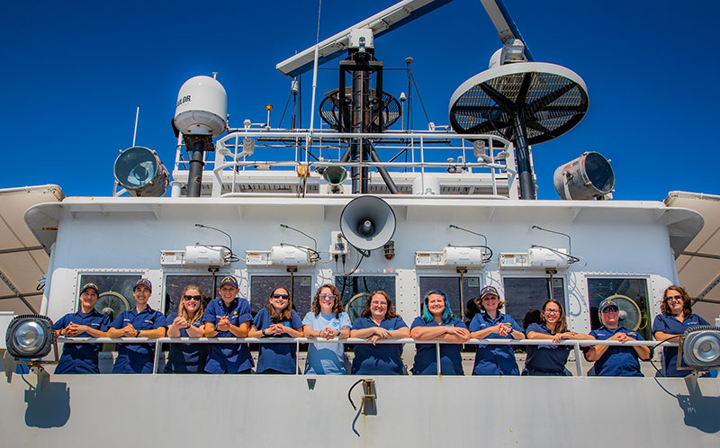 Over 25% of the mission and crew team aboard NOAA Ship Okeanos Explorer for the Windows to the Deep 2019 expedition are women, including the Commanding Office (CO), Executive Officer (XO), Operations Officer (OPS), Expedition Coordinator, Mapping Lead, and Science Leads! This is the first time this has happened onboard the Okeanos Explorer, and is a rarity amongst oceanographic research vessels.
